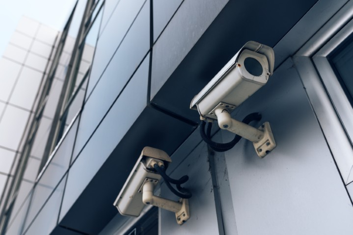 Two surveillance cameras on modern building for private property protection